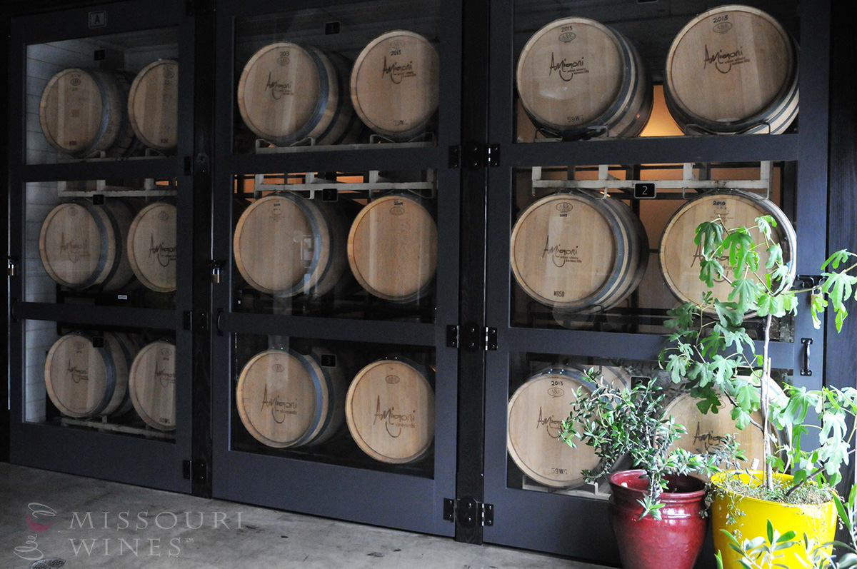 Spotlight on Missouri Wine Country: KC Area | A wall of barrels aging Missouri wine at Amigoni Winery in the West Bottoms.
