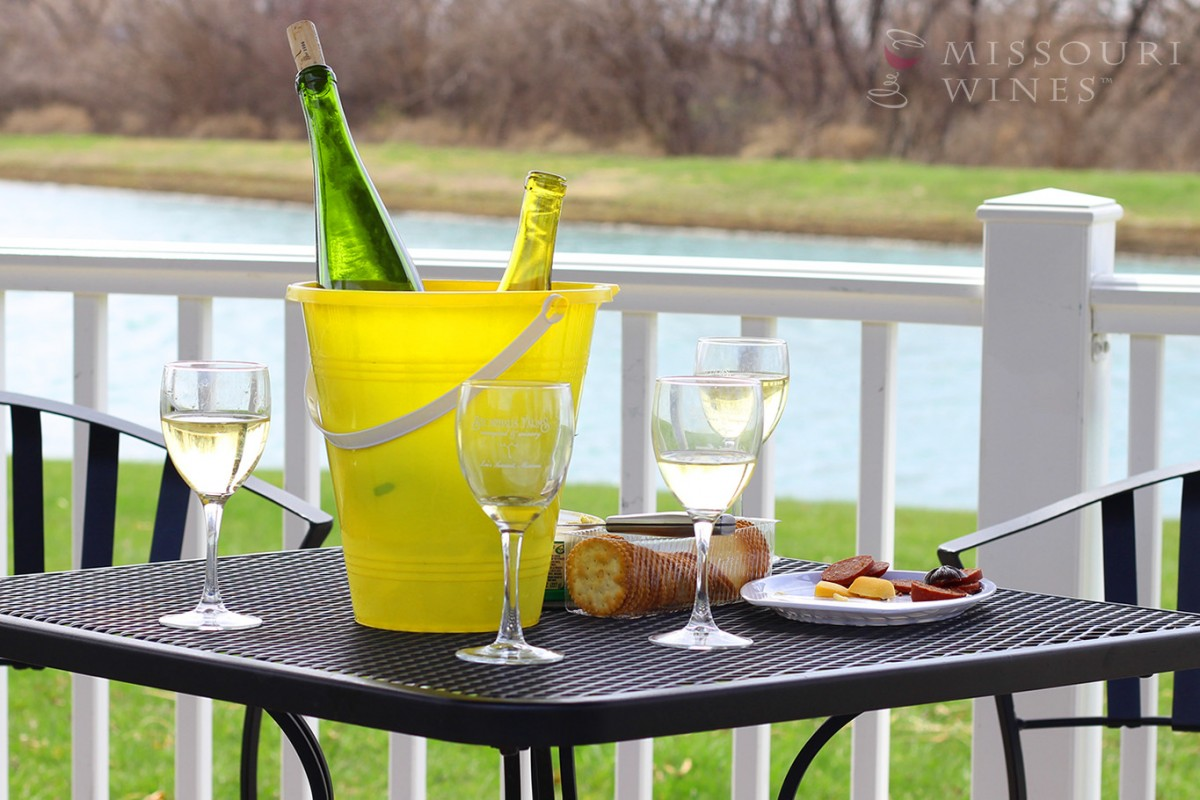 Spotlight on Missouri Wine Country: KC Area | Stonehaus Farms Vineyard & Winery has a lovely patio overlooking a lake where you can enjoy award-winning Missouri wine.