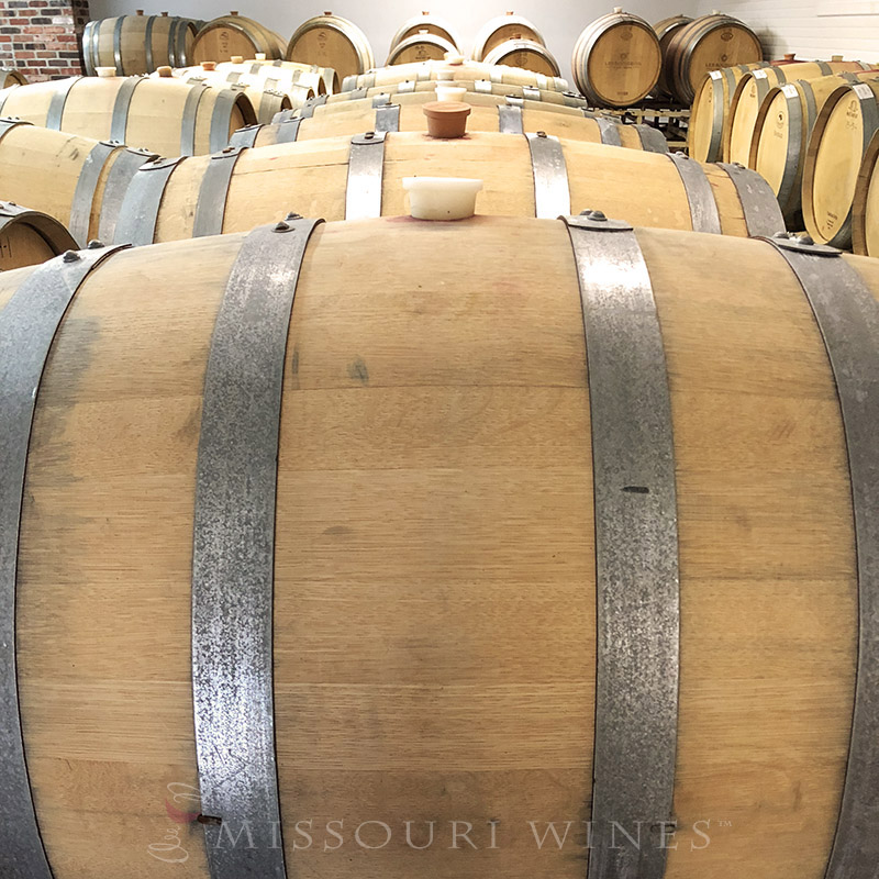 Winter Winemaking in Missouri | A barrel room holds many wines on their way to becoming complex and delicious.