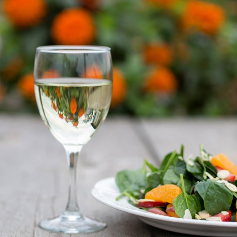 Chilled White Wine in Outdoor Setting with Salad