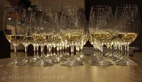 Glasses of Missouri white wine lined up on a table