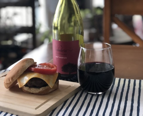 Red wine burger with glass of wine