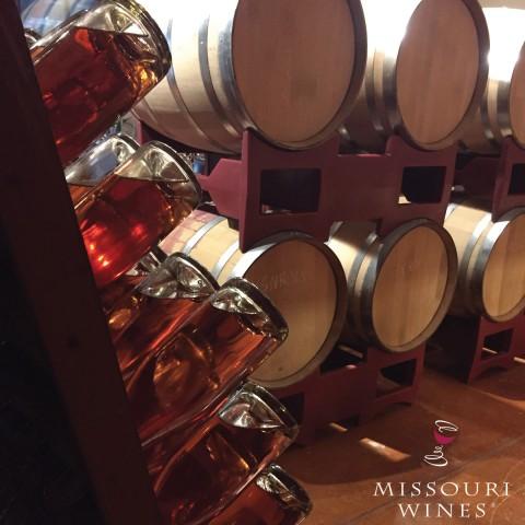 wine bottles and wine barrels